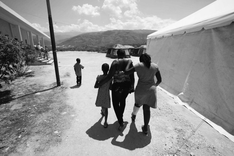 Children walk at the Albert Einstein Hospital north of Port-au-Prince on Wednesday. Aid workers say they are having a difficult time connecting displaced children with their parents.