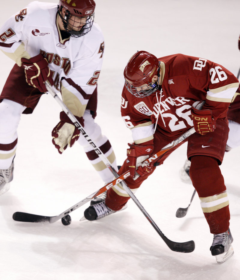 Brian Dumoulin, left, a freshman defenseman from Biddeford, is living his dream this week playing for Boston College in the NCAA men's hockey Frozen Four.