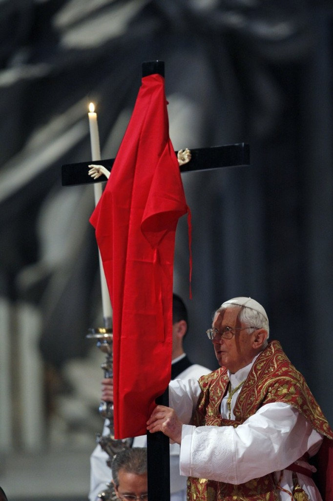 The Associated Press Pope Benedict XVI uncovers a crucifix draped in red during a service in St. Peter's Basilica at the Vatican on Friday, preparing for Good Friday ceremonies.