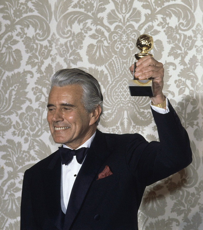 "The Associated Press Actor John Forsythe celebrates after accepting the Golden Globe Award for best actor in a dramatic television series, ""Dynasty,"" in 1983."