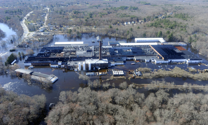 Floodwaters remain in parts of southern Rhode Island where Homeland Security Secretary Janet Napolitano did a flyover Friday, calling the damage significant and saying she's considering a plea by officials for additional federal aid.