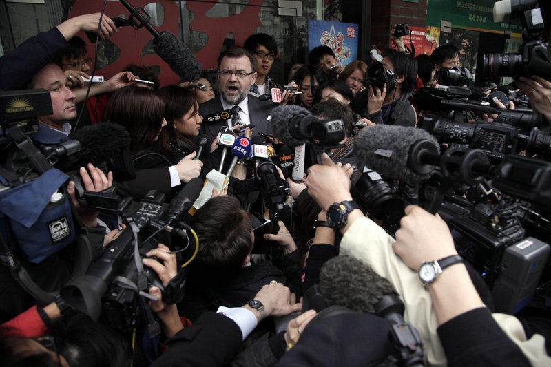Tom Connor, Australia's consul-general in Shanghai, China, center, briefs journalists Monday, when four employees of British-Australian mining giant Rio Tinto were convicted of bribery charges and sentenced to prison.
