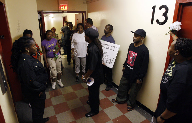Residents and others gather in a Rowan Tower hallway, left, to protest the March 28 gang-rape of a 7-year-old girl in Trenton, N.J. Police are certain residents know who participated in the crime, but expect little help from them because of the fear of retaliation.