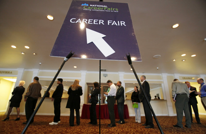 Job seekers attend a career fair put on by National CareerFairs in San Jose, Calif., on Tuesday. The nation's economy created the largest number of jobs last month since the recession began, while the unemployment rate remained at 9.7 percent.