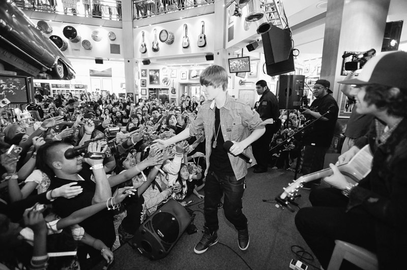 Canadian pop singer Justin Bieber performs as part of the March on Stage benefit concert series at the Hard Rock Cafe in Los Angeles on Friday. Hard Rock will donate proceeds from the events in North America to Musicians on Call, an organization founded with the mission of bringing live and recorded music to the bedsides of patients in health-care facilities.