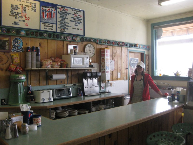 Jancy Kowalski stands behind the counter at Judith Gap Mercantile, where she makes milkshakes for Air Force service members who maintain missiles housed in Judith Gap, Mont.