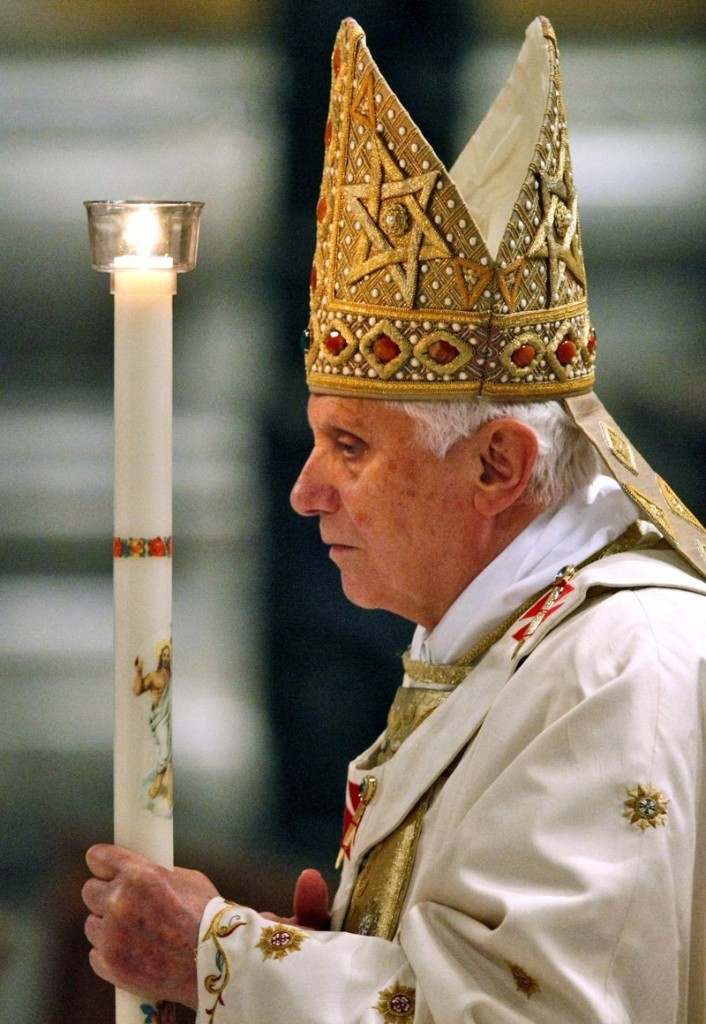 "Pope Benedict XVI walks with a candle during the Easter Vigil Mass at the Vatican on April 3. One reader called a decision by the Catholic Diocese of Portland to revoke funds to a group that serves the homeless ""the last straw in the long string of ... reprehensible acts and decisions"" by the local and world church hierarchy."