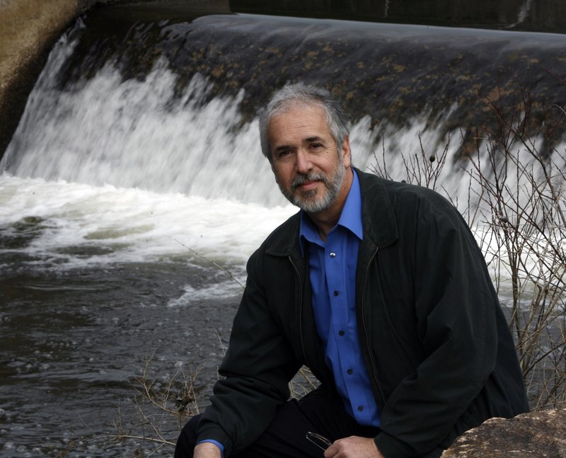 Norm Labbe, water district superintendent, sits by Branch Brook, a water source in Kennebunk. Many utilities are raising rates because water use is down – but, readers say, that's no reason to consider selling any of it.