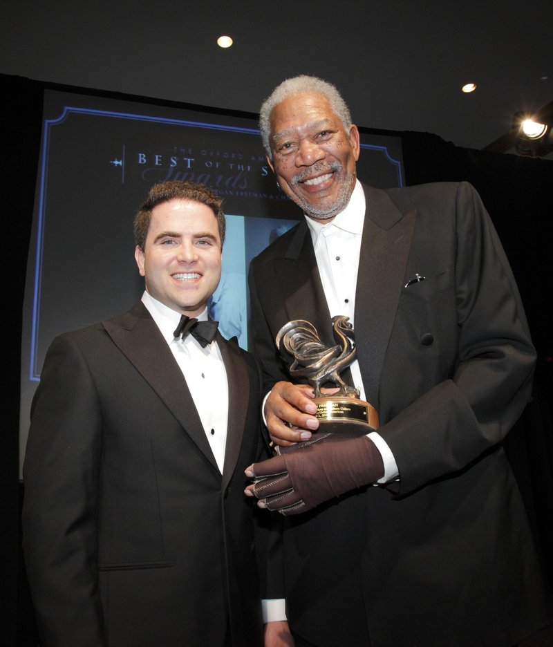 Oxford American Publisher Warwick Sabin presents the Oxford American award for outstanding contribution to southern culture to actor Morgan Freeman at the Best of the South Gala in Little Rock, Ark. Saturday.