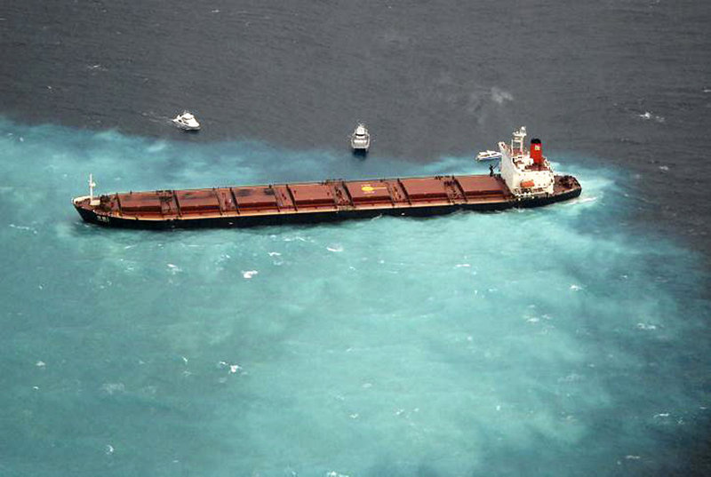 The Chinese coal-carrying ship Shen Neng 1 is hard aground and leaking oil on Australia's Great Barrier Reef on Sunday.