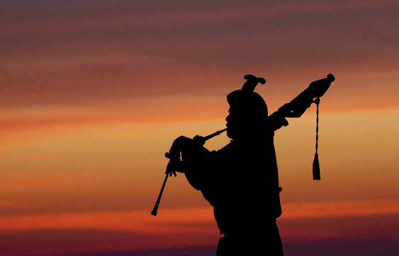 David Smart of Scarborough plays the bagpipes during the Easter sunrise service at Fort Williams Park.