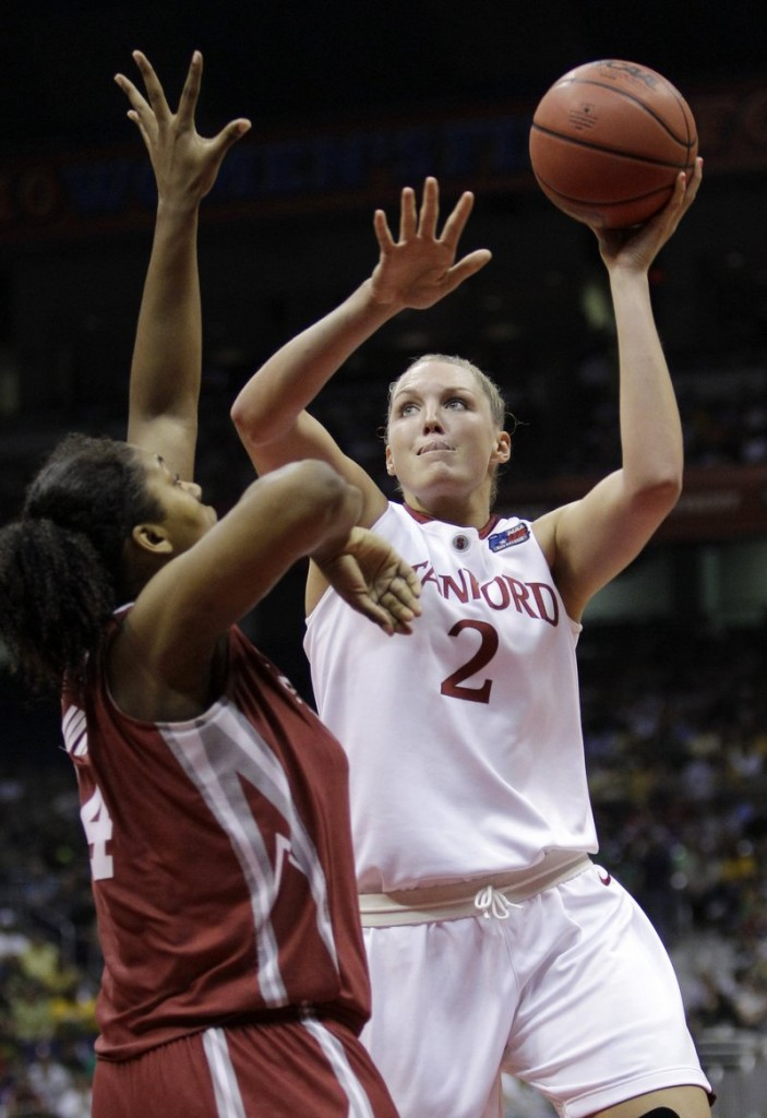 Jayne Appel of Stanford shoots over Oklahoma's Abi Olajuwon during an NCAA women's semifinal Sunday night. Stanford reached the final with a 73-66 victory.