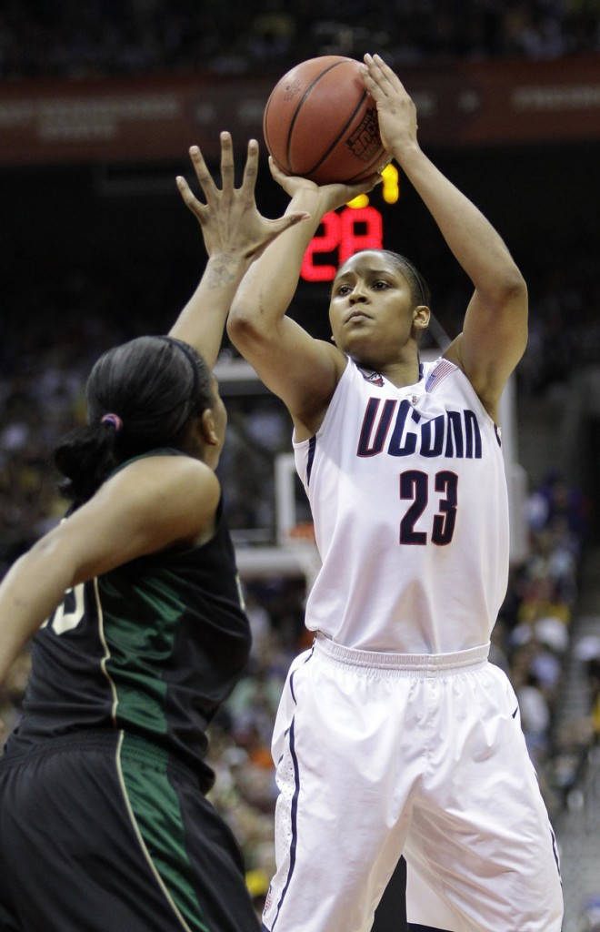 Maya Moore shoots over Morghan Medlock during Connecticut's 70-50 win over Baylor. Moore finished with 34 points and 12 rebounds.
