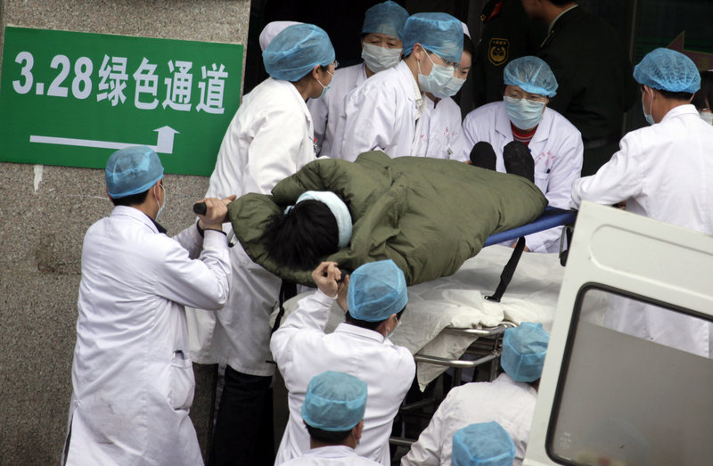 A coal miner rescued from the Wangjialing mine is rushed to a hospital in Hejing town in north China's Shanxi province Monday. More than 100 Chinese miners were pulled out alive after being trapped for more than a week in a flooded coal mine, sparking cheers among the hundreds of rescue workers who had raced to save them and almost given up hope.