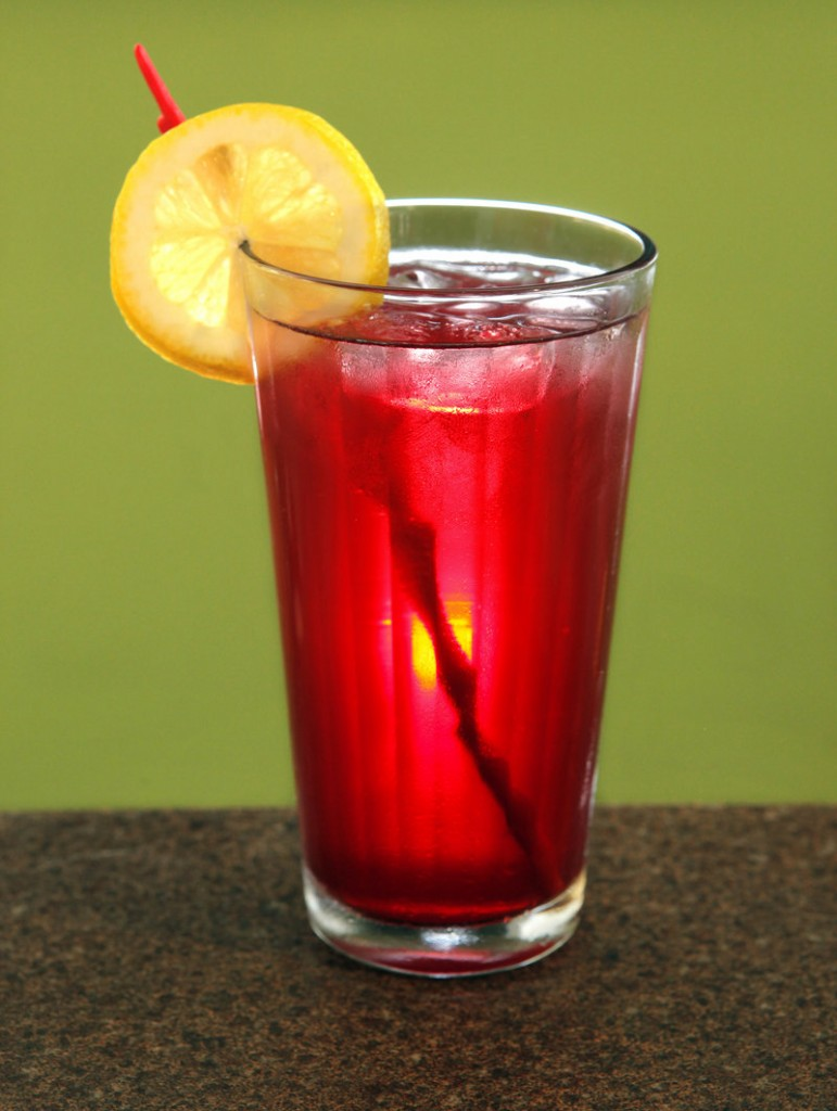 This colorful concoction, created by Jo Moser of the Greenlight Studio and Cafe in Portland, is made with 100 percent pomegranate juice, seltzer and a slice of lemon, served on the rocks.