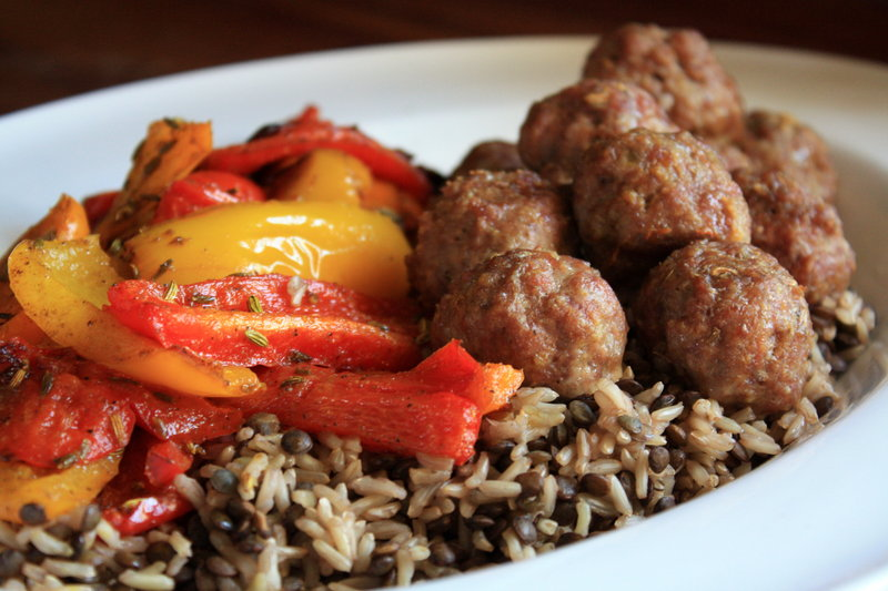 Curried lamb meatballs with roasted peppers and brown rice.