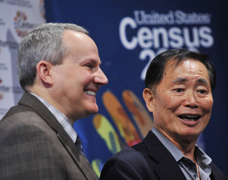 Actor George Takei, right, and his husband, Brad Altman, speak at a news conference Monday in New York. The Census Bureau unveiled public service videos encouraging gays and lesbians to mail in their census forms.