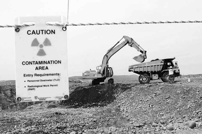 Workers remove waste in an area near two dormant nuclear reactors on the Hanford nuclear reservation, near Richland, Wash., in 2004. A recent Obama administration decision to withdraw licensing for a repository at Nevada's Yucca mountain could mean the Hanford waste will remain there indefinitely.
