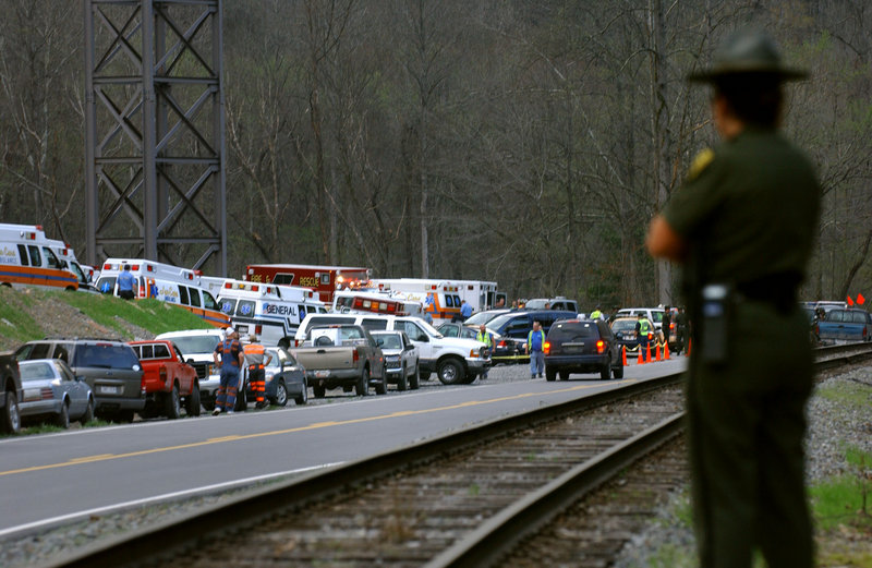 Authorities survey the scene of an explosion that killed 12 miners Monday at the Upper Big Branch mine in Montcoal, W.Va. The Massey Energy Co. underground coal mine has had three other fatalities in the past dozen years.