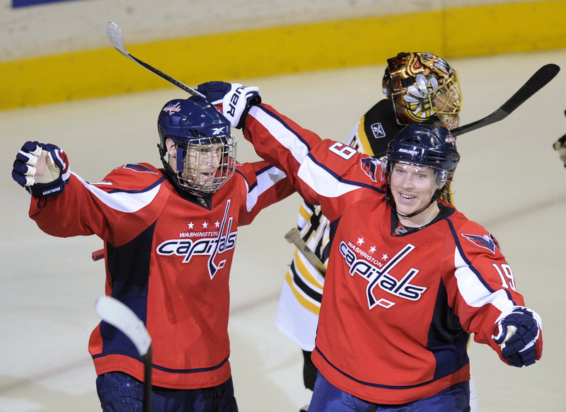 Brooks Laich, left, celebrates with Nicklas Backstrom after scoring a power-play goal in overtime to give the Washington Capitals a 3-2 win Monday over the Boston Bruins.