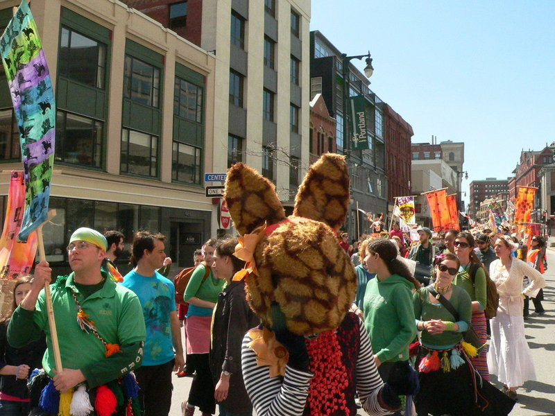 Last year's Ebune paraders form a colorful procession through downtown Portland as they celebrate spring. This year's event starts at noon Sunday.