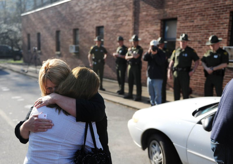 Michelle McKinney hugs Jeannie Sanger, in white, in Whitesville, W.Va.,on Tuesday. Benny Willingham, Sanger's brother and McKinney's father, died in a blast at Massey Energy's Upper Big Branch mine.