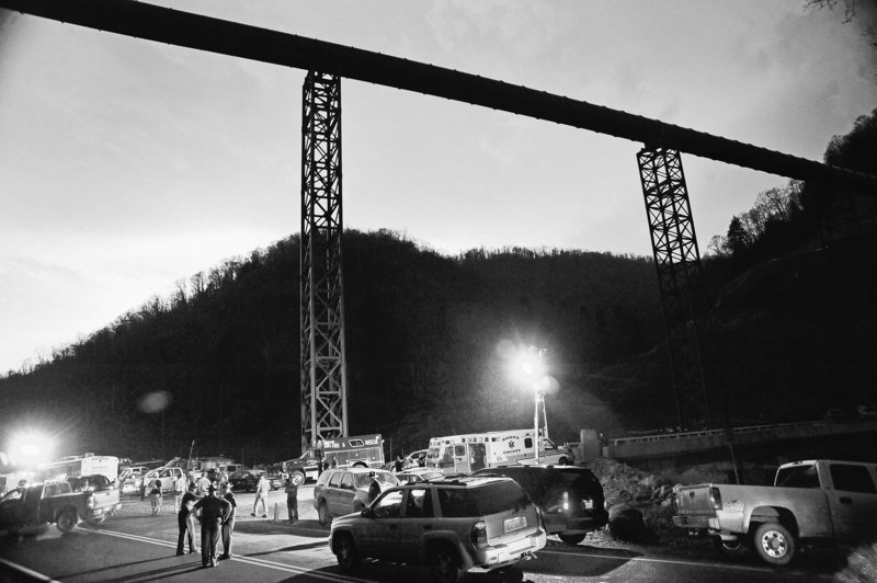 State police direct traffic at the entrance to Massey Energy's Upper Big Branch mine in Montcoal, W.Va., Monday, when an explosion killed at least 25 workers. The blast is believed to have been caused by a buildup of methane.