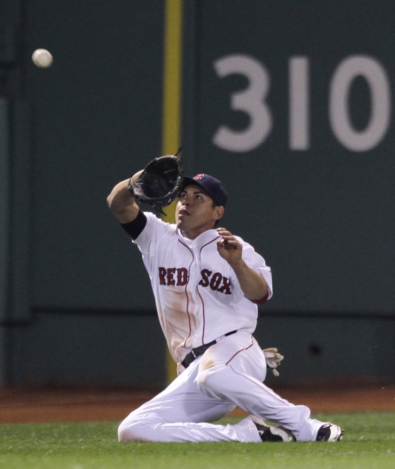 Jacoby Ellsbury of the Red Sox makes a sliding catch on a ball hit by Mark Teixeira of the New York Yankees in the seventh inning Tuesday night. The Yanks won, 6-4.