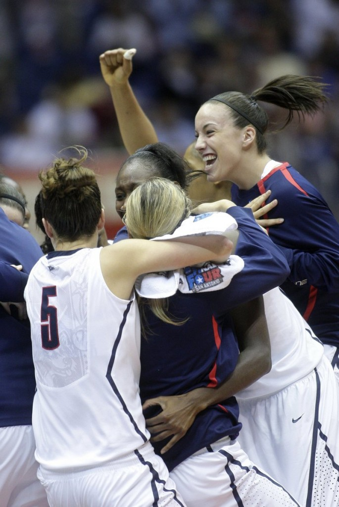 Top-ranked Connecticut does it again, celebrating a second straight NCAA women's title after rallying in the second half for a 53-47 victory over No. 2 Stanford in the final at San Antonio on Tuesday night.