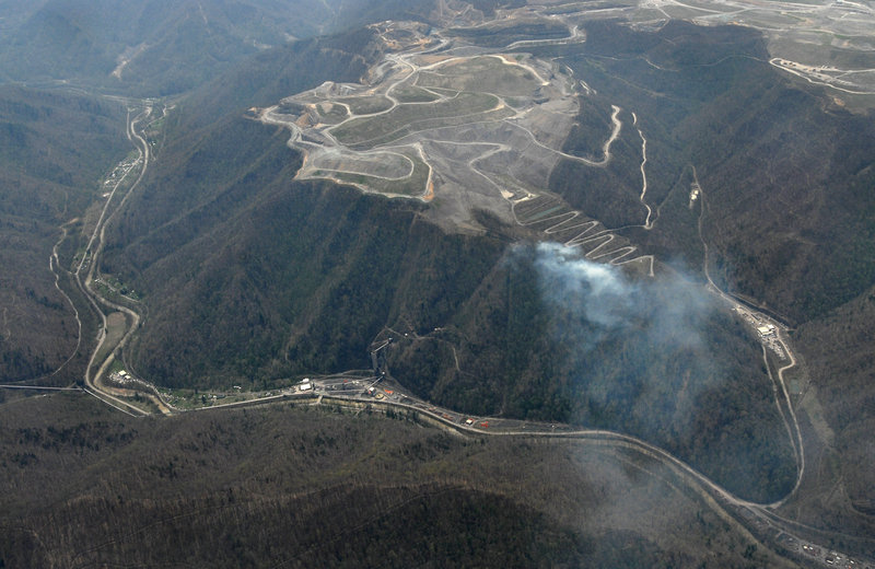 The Massey Energy Complex near Montcoal, W. Va, is seen in an aerial photo on Wednesday. A Massey executive said Thursday that more drilling is needed to help clear a West Virginia mine of dangerous gases.