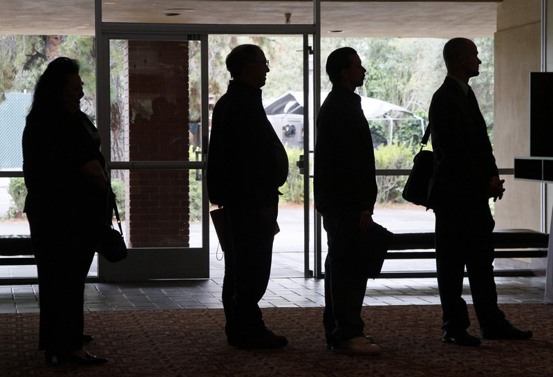 Job seekers await the start of a San Jose, Calif., career fair. Some of the people now receiving welfare may have been laid off and still have