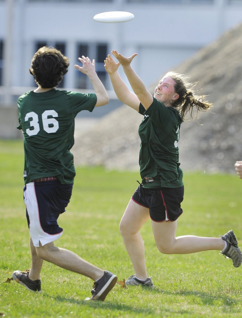 Merrigconeag teammates Carson Davis, left, and Sierra Jeffers close in on a pass against Falmouth.