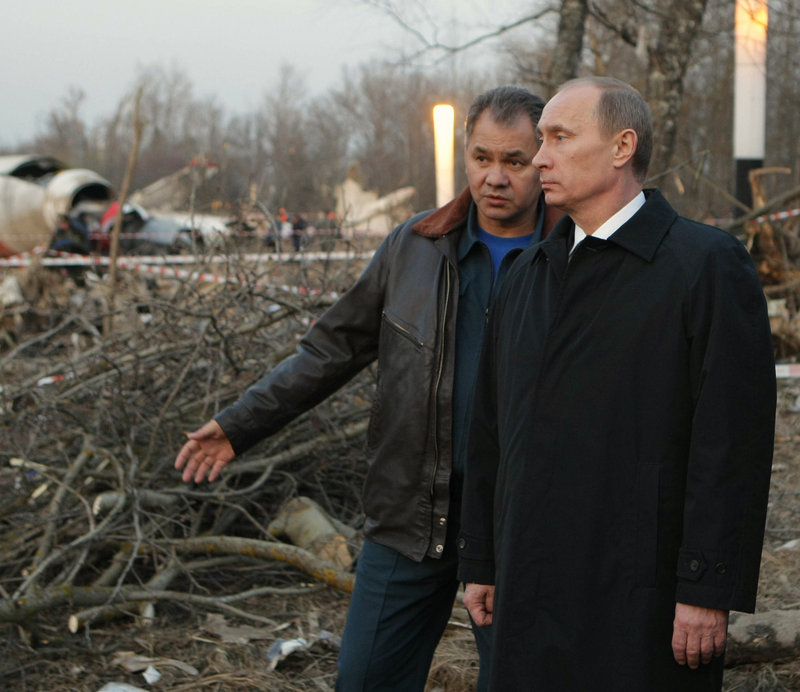 Russian Prime Minister Vladimir Putin, right, and Emergency Situations Minister Sergei Shoigu visit the crash site of the plane in which Polish President Lech Kaczynski died, near Smolensk, western Russia, on Saturday.