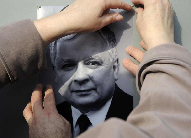 Polish Embassy employees place the portrait of President Lech Kaczynski near the embassy headquarters in Kiev, Ukraine, on Saturday.