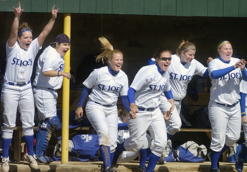 The players in the Monks' dugout celebrate during a five-run sixth inning that helped St. Joseph's overcome a 9-5 deficit in the opener.