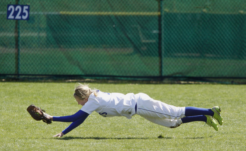 Danyelle Shufelt makes a diving catch in right field for St. Joseph's in the fifth inning of the first game of a doubleheader Saturday against Pine Manor. The Monks rallied for a 10-9 victory, then completed the sweep by beating the Gators 8-6 in the second game to up their win streak to 17.