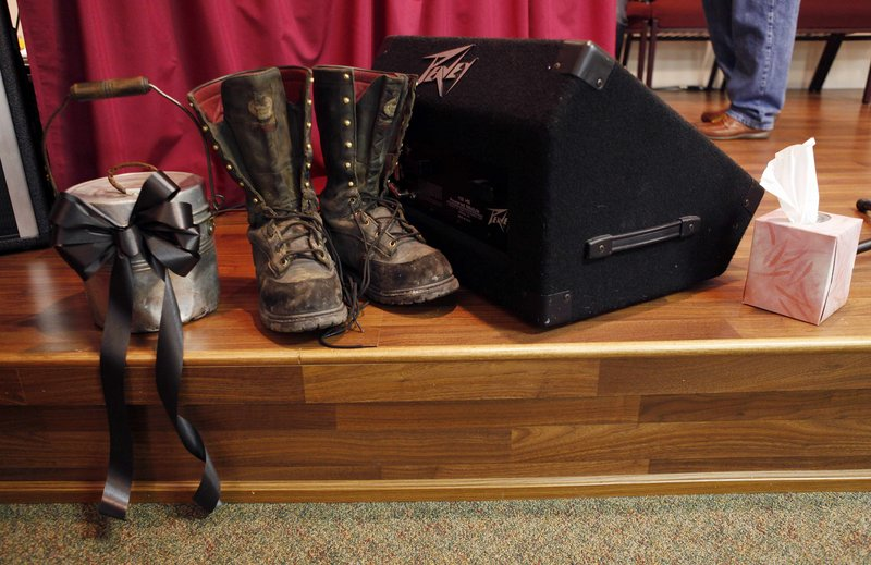 Coal mining boots and a lunch pail sit near the altar at the church.