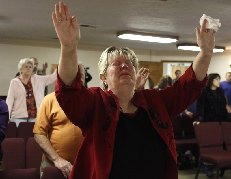 Judy Walker cries during a Sunday service at New Life Assembly church in Pettus, W.Va.