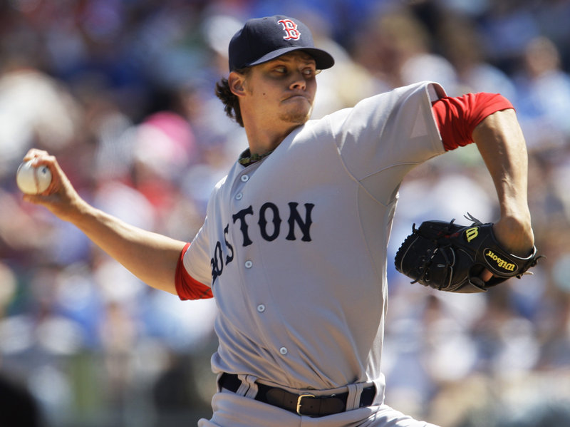 Clay Buchholz got a win in his first start of the season for the Red Sox after giving up two earned runs and seven hits in five innings as Boston beat Kansas City, 6-4.