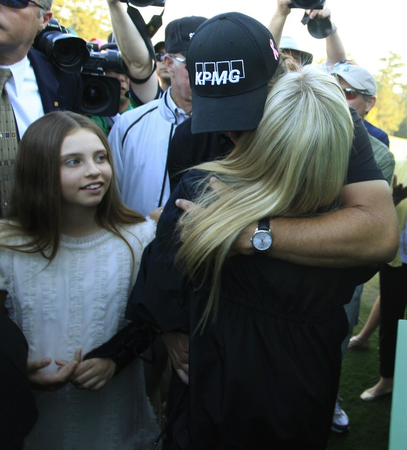 With daughter Amanda at his side, Mickelson shares a long embrace with wife Amy, who is undergoing treatment for breast cancer.