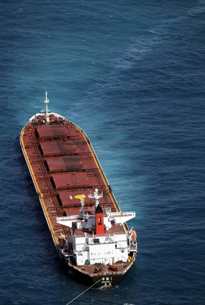 A ribbon of oil trails the Chinese-registered bulk coal carrier Shen Neng 1 after the ship ran aground last week off the coast of Australia.