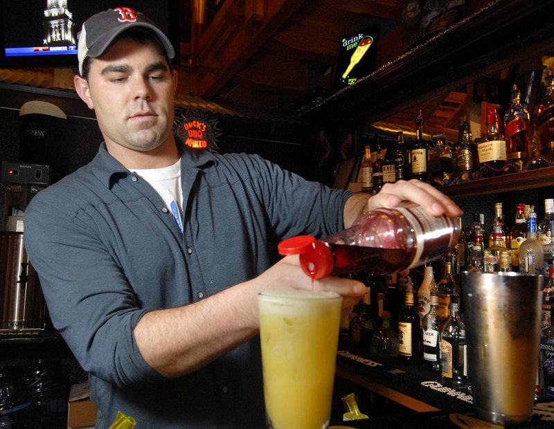 Bartender Nick Duffy mixes up a specialty drink at the new Buck's Naked BBQ on Route 302 in North Windham, a second location for the popular Freeport restaurant.