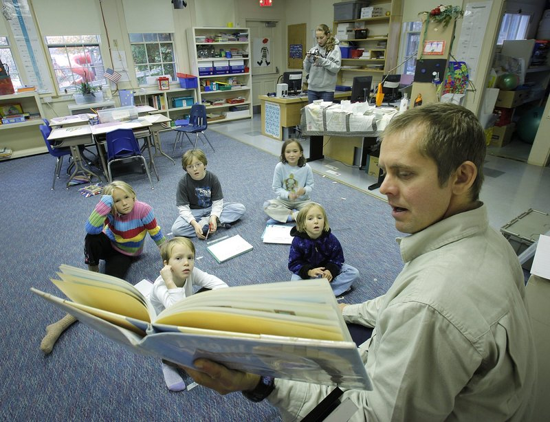 Teacher Josh Holloway reads a book to his students at Cliff Island School in this 2009 file photo. Giving young pupils a solid foundation can help teachers in higher grades do a better job, readers say.