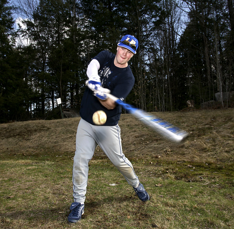 Danny Place, a junior catcher, uses an aluminum bat as a power hitter for Lake Region High, but also travels to play in a wooden-bat league in Massachusetts.