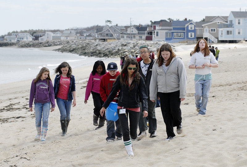 Naturalist Jinx Bauer and Lincoln Middle School seventh-graders head onto Ferry Beach on Monday to learn about ecosystems near the mouth of the Saco River.