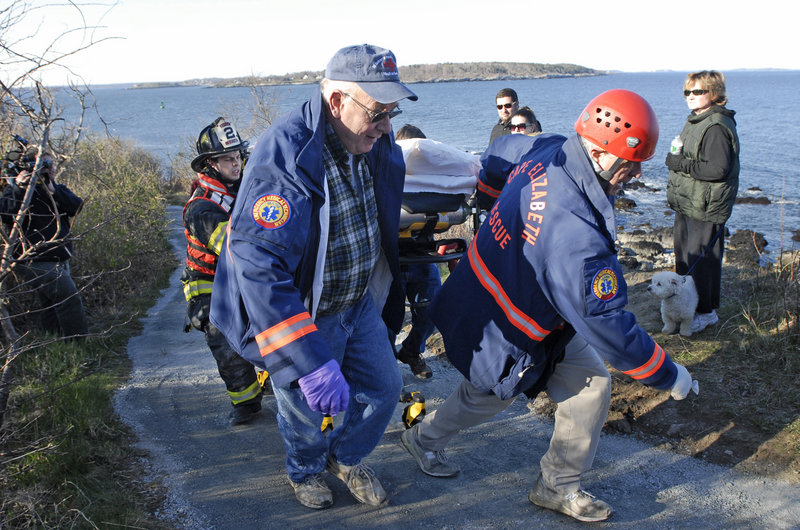 Cape Elizabeth Rescue personnel carry a man up a trail at Fort Williams Park after he had fallen from a cliff along the Cape Elizabeth shoreline Tuesday.