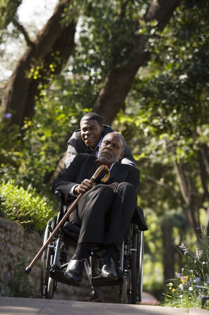 "Tracy Morgan, pushing, and Danny Glover are two of the family members in Chris Rock's cover of ""Death at a Funeral."""