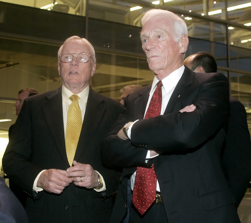Astronauts Neil Armstrong, left, and Eugene Cernan – the first and last men on the moon – talk during a reception in Armstrong's honor at Purdue University in West Lafayette, Ind. in 2007.