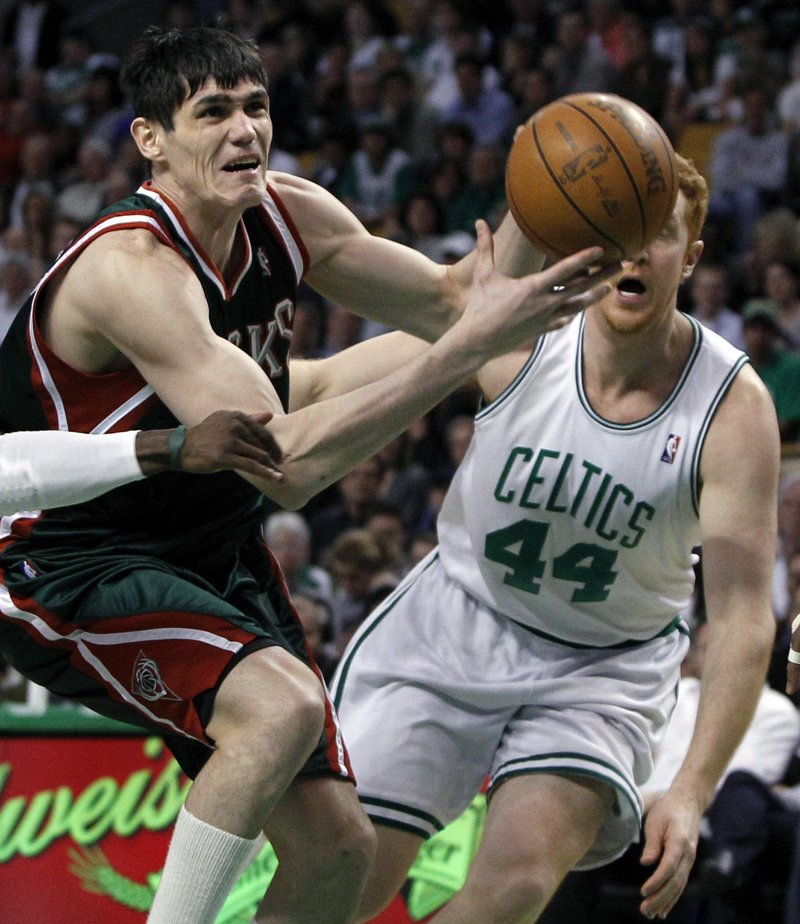 Ersan Ilyasova of the Milwaukee Bucks drives against Brian Scalabrine of the Boston Celtics in the first quarter of Milwaukee's 106-95 victory Wednesday night.