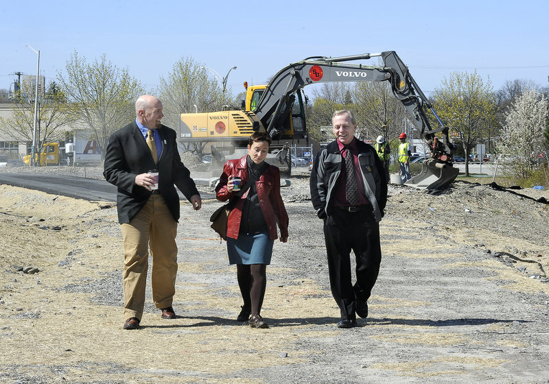 Jim Gooch, Nan Cumming and Mark McAuliffe explore the construction in progress for the trail. Some critics say the greenway concept is not an efficient use of the urban grid, but supporters say open space and a pedestrian infrastructure are important features.